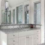 A little bit goes a long way - a lovely patterned tile on a small vanity backsplash can elevate a room's design.