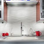 These large wavy tiles keep this kitchen backsplash clean and bright without sacrificing style.