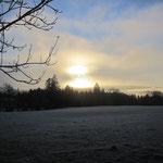 Sonnenaufgang im Hochnebel