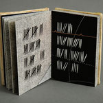 Marking Time (1997) intaglio, relief-rolled intaglio, hand coloring and letterpress, covers are low-fired ceramic, edition of five, 3.25 x 2.25 inches
