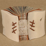 Bone Vessel (2002) found text, sewn with a long-stitch on manuscript vellum, covers are animal rib bones, unique, 3.25 x 2.25 inches, Herron School of Art and Design Library