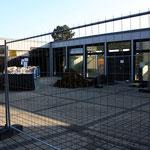 1.10.14 Hier sollen die bestehenden Gebäude durch einen Glasanbau erweitert werden, der in den Innenhof hineinragt