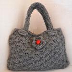 kleine graue Handtasche