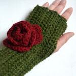 Handstupen mit Blüte