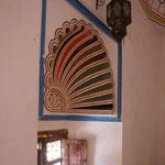 Ein Gästezimmer mit Originalverzierungen