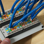 Punch down connections on the back of the patch panel.