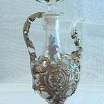 Ampollina in vetro con decorazioni in metallo. Bottega toscana sec. XVIII