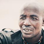 himba man epupa falls, faces of namibia