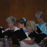 Marie Stricker directed the Sacred Heart Church Choir in the Bilingual Mass.