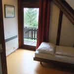 Kleines Schlafzimmer OG mit Zugang zum Balkon und Seeblick