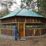 The 2015 finished Information Center of the Wondo Genet College Arboretum. Up to 30 students can listen to lectures and discuss e.g. the taxonomy of tree species inside this airy, round hut. ARBONETH provided several posters on the importance of ex situ c