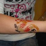 Drachen Tattoo Glitter Tattoo von den Facepainters in Hinte Emden Aurich Norden Leer & die Krummhörn