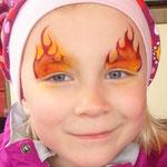 Kinderschminken Feuer von den Facepainters für die Fresena Apotheke in Hinte