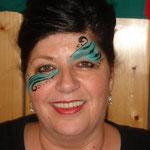 Face painting in türkis geschminkt von den Facepainters in Emden Leer Aurich Norden
