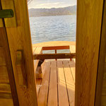 Blick aus der Sauna auf den See