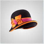 """""""Emma"""" schwarzer Aufschlaghut, handgezogen mit orange-pinker Garnitur. € 320,-"""
