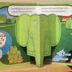 Kofferbuch / Besuch bei Luu  - Seite mit ausgeklapptem Bild