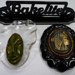 Bakelite and lucite mask brooch. Egyptian inspired bakelite brooch.