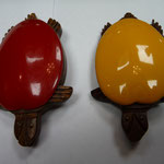 Bakelite and rosewood brooches.