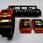 Bakelite clamper bangle and dress clips, red and black.