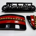Belt buckle and dress clip. Bakelite 40s.