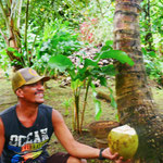 Drinking fresh coconut water from André's garden