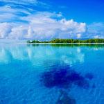 SE motu with coral bommie in 10m depth