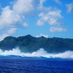 Large swell breaking on the reef in Tahaa