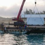 Unloading via barge an crane
