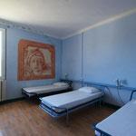 Chambre de trois lits