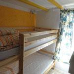 De derde slaapkamer met stapelbed.