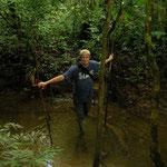 Jeroen crossing a ungle stream