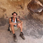Having a break among indian petroglyphs.
