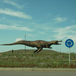 Traffic sign eating Dinosaur.
