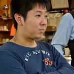 観戦する喜島安広球聖