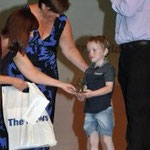 Frances and Julie present Sam with his 'Inspiration of the year' award'