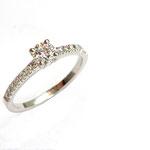 solitaire accompagné platine et diamants