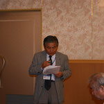 明坂宣行事務局長による事業報告と決算報告