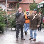 Weihnachtsbaumverkauf mit Megafon
