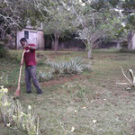 Joe cleaning the grounds of our recently donated house which is going to serve as the OKYENA-NTSI orphanage.