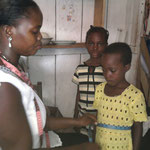 Regina at work measuring the kids for uniforms. She does all this work for FREE.
