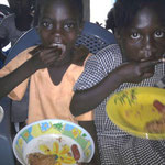 School children enjoying a hearty meal courtesy of OKYENA-NTSI Foundation