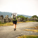 Pilgrims walk on rocky street
