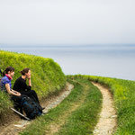 Resting pilgrims enjoying the ocean view