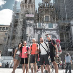 Pilgrims in front of the cathedral façade restoration site on Obradoiro square