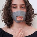 """Maske 17 """"smile or not"""" von Haldis Scheicher, 2020, Silber, Foto auf Karton foliiert / Kleinserie / Foto: Dora Kuthy"""