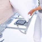 Mit dem optionalen Bedienmodul in der Bettzeugablage des Puro lassen sich die Verstellfunktionen komfortabel verwalten.