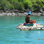 """Ein Fischer auf seinem """"Boot"""""""