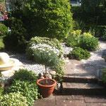 Teichentfernung, Plattenverlegung, Brunnenerstellung und Steingarten