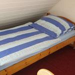 Einzelbett im Wohnbereich